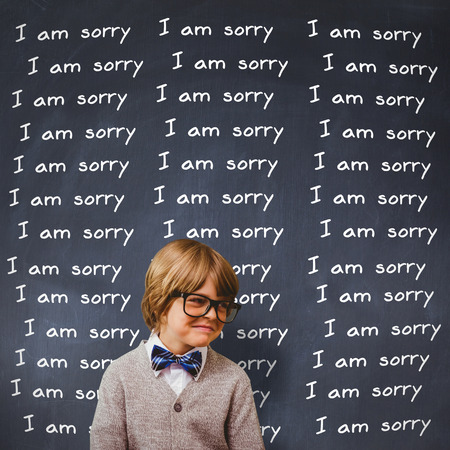 i am sorry: Cute pupil dressed up as teacher against black background