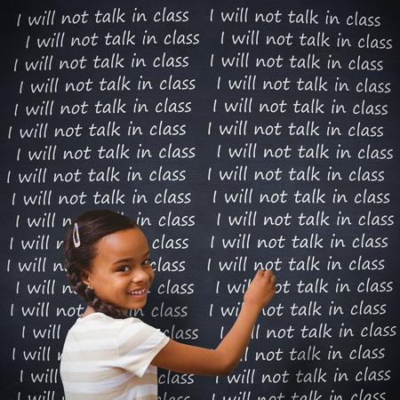 pupil: Pupil writing against blackboard Stock Photo