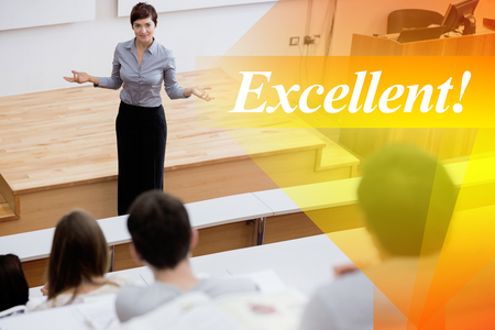 lecturing hall: The word excellent! against teacher standing talking to the students