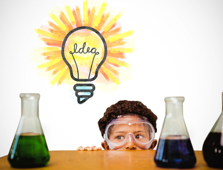 scientist: Cute pupil dressed up as scientist against white background with vignette Stock Photo