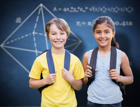 indian school girl: School kids against blue chalkboard Stock Photo