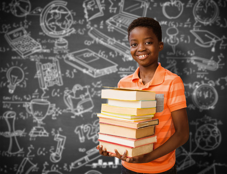 higher intelligence: Portrait of cute boy carrying books in library against black background