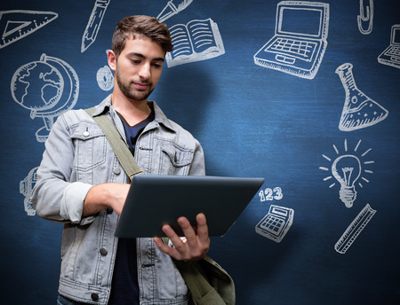 numeracy: Student using tablet in library  against blue chalkboard