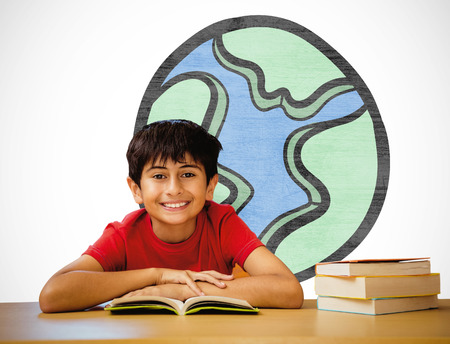 vignette: Cute boy reading book in library against white background with vignette Stock Photo