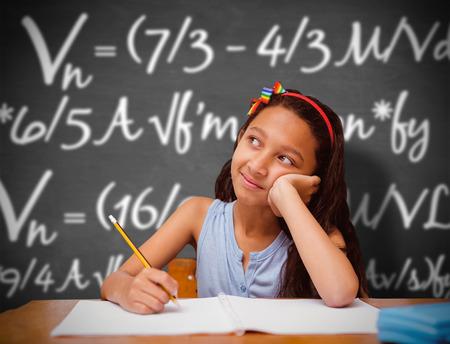 pupil: Cute pupil at desk against black background