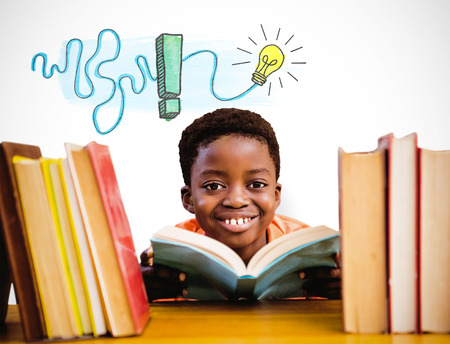 school library: Cute boy reading book in library against white background with vignette Stock Photo