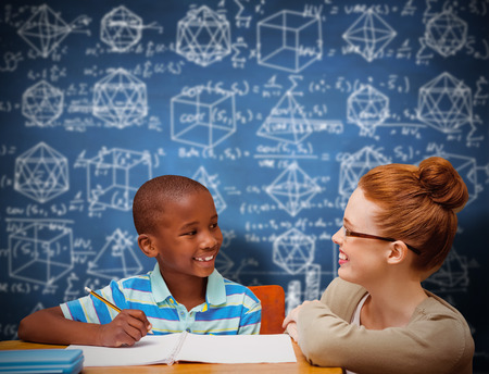 pupil: Happy pupil and teacher against blue chalkboard