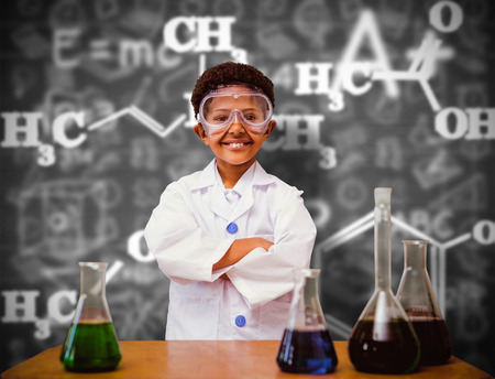 chemistry formula: Cute pupil dressed up as scientist against black background