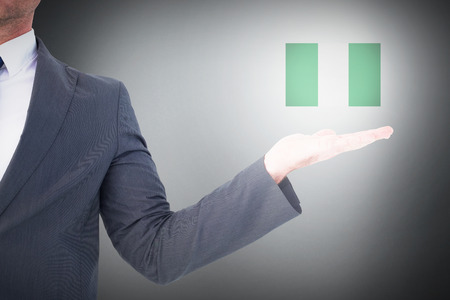 hand out: Businessman with his hand out against grey background