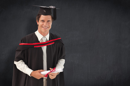 graduating: Man Graduating from University against blackboard