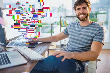 graphics tablet: Graphic designer using a graphics tablet against international flags Stock Photo
