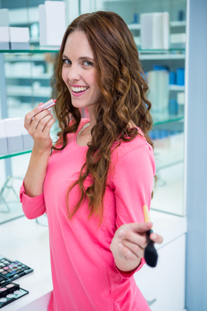 cosmetic products: Pretty woman shopping for cosmetics at the pharmacy Stock Photo