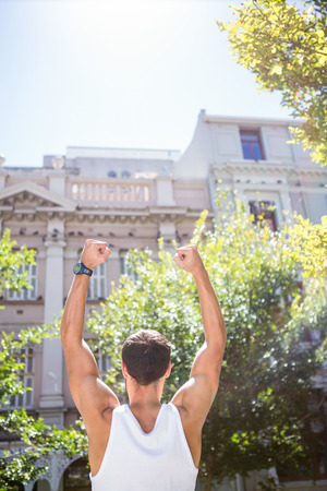 turned out: Rear view of an athletic man gesturing victory on a sunny day Stock Photo