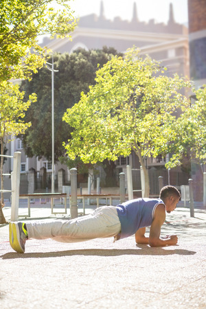 plank position: A muscular man on plank position on a sunny day Stock Photo
