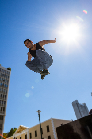 hardcore: Man doing hardcore parkour in the city on a sunny day Stock Photo