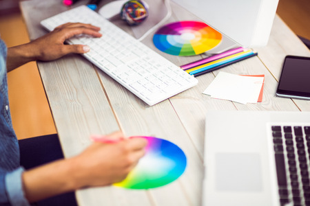 Graphic designer working with colour chart at workplace Stock Photo