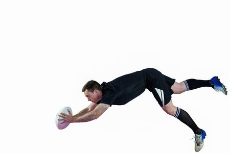 pelota rugby: Un jugador de rugby determinado anotar un try