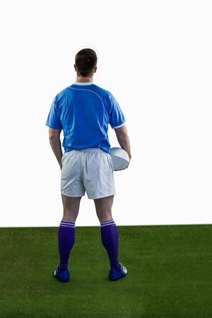 pelota rugby: Volver convertido jugador de rugby sosteniendo una pelota de rugby