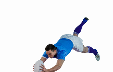 scoring: A determined rugby player scoring a try Stock Photo