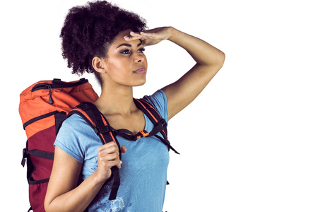 far away look: Young woman with backpack looking away against a white background