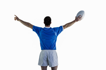 turned out: Rugby player gesturing with hands and holding a rugby ball