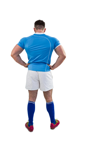 hands on hips: Rugby player with hands on hips on white background