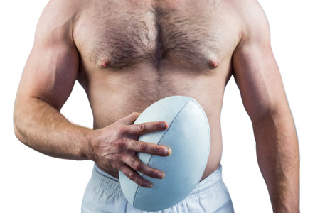 cut the competition: Shirtless rugby player holding ball on white background Stock Photo