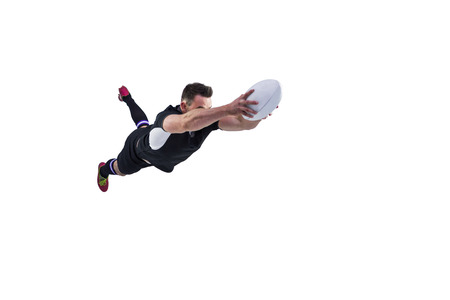 scoring: Rugby player scoring a try on white background