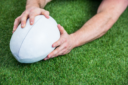 scoring: Rugby player scoring a try on astro turf grass Stock Photo