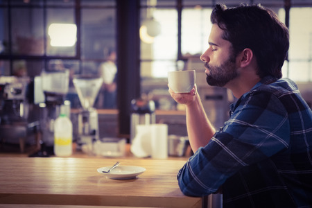 Worried man drinking a coffee at the cafe