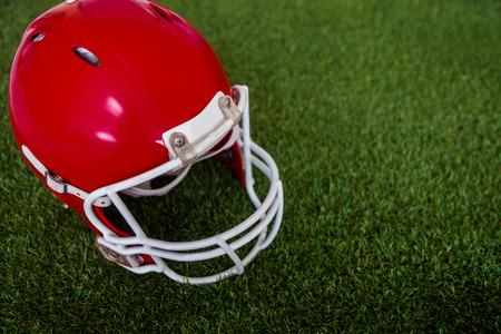 american football: Upward view of an american football helmet on the field