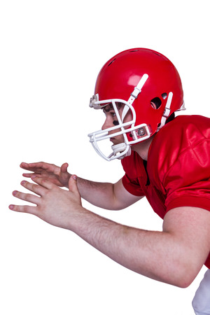 profile view: Profile view of an american football player about to catch a ball Stock Photo
