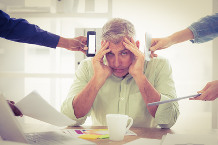 overwrought: Portrait of an overwrought businessman with hands on head at the office Stock Photo