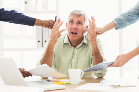 overwrought: Overwrought businessman claiming for help at the office