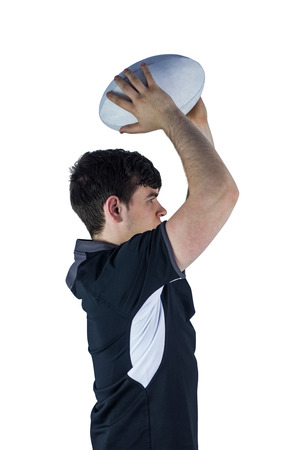 profile view: Profile view of rugby player throwing a ball on a white background Stock Photo