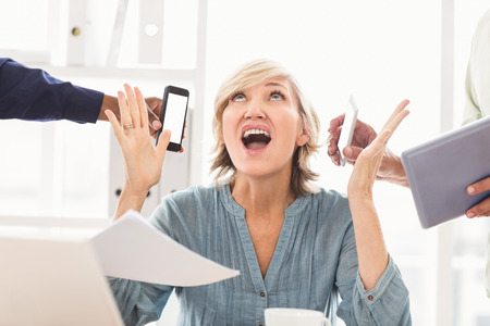 overwrought: Overwrought businesswoman claiming for help at the office