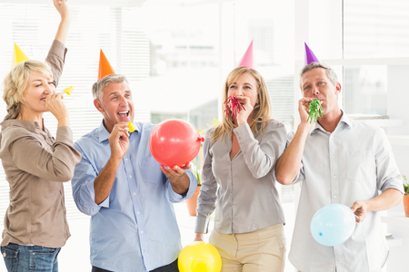 casual business: Casual business people celebrating birthday in the office Stock Photo