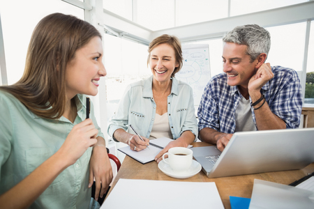 business casual: Casual business people speaking together in office