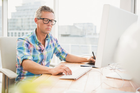 digitizer: Casual designer using computer and digitizer in the office Stock Photo