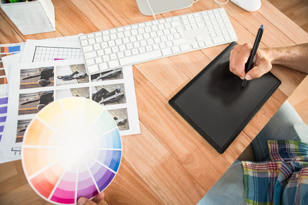 digitizer: Casual designer working with digitizer in the office