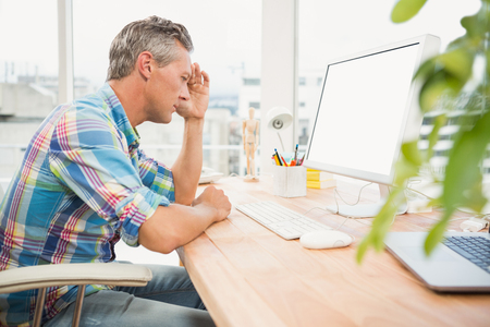 angry computer: Frustrated casual designer using computer in the office