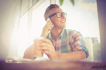 phone professional: Smiling casual designer having a phone call in the office Stock Photo