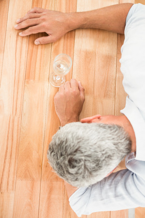 overworked: Overworked casual businessman resting on wooden desk