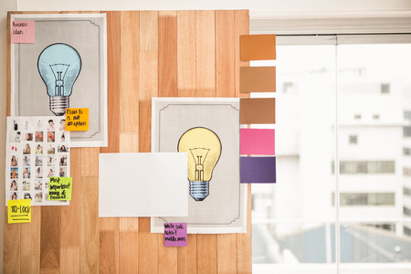 sticky notes: Illustrations and sticky notes on wooden wall in the office