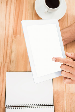 blank tablet: Hands holding blank screen tablet on wooden desk