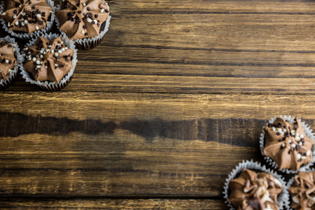 Chocolate cupcakes on a table shot in studio Stock Photo