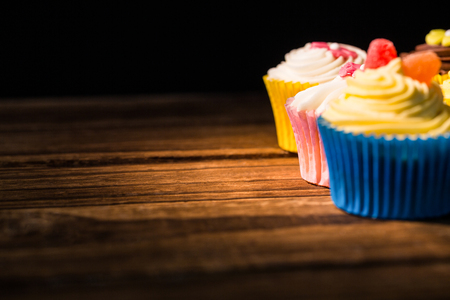 calorific: Delicious cupcakes on a table shot in studio