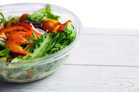 Healthy bowl of salad on table shot in studio