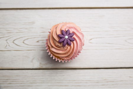 calorific: Delicious cupcake on a table shot in studio