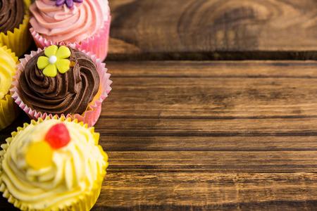calorific: Delicious cupcakes on a table shot in studio